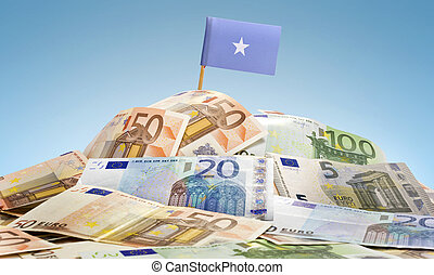 Flag of Somalia sticking in a pile of various european banknotes.(series)