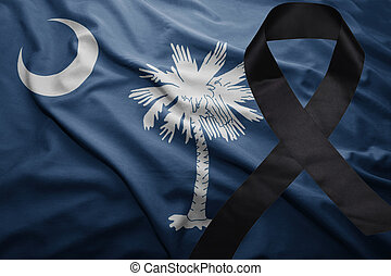flag of south carolina state with black mourning ribbon