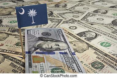Flag of South Carolina sticking in various american banknotes.(series)