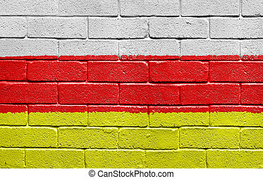 Flag of South Ossetia on brick wall