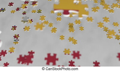 Flag of Spain being made with jigsaw puzzle pieces. Spanish...