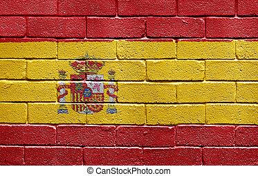 Flag of Spain on brick wall