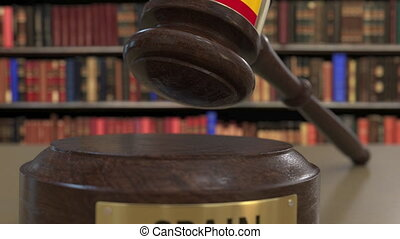 Flag of Spain on falling judges gavel in court. National...