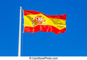 Flag of Spain waving in the wind against the sky