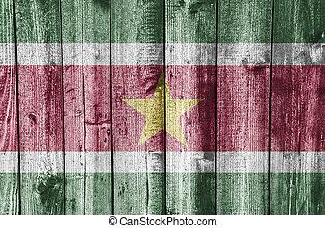 Flag of Suriname on weathered wood