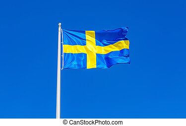 Flag of Sweden flying in the wind against the sky
