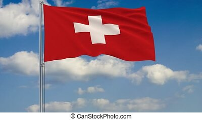 Flag of Switzerland against background of clouds