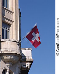 National flag of Switzerland blowing in the wind. Luzern
