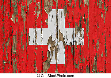 Flag of Switzerland on a weathered wooden wall