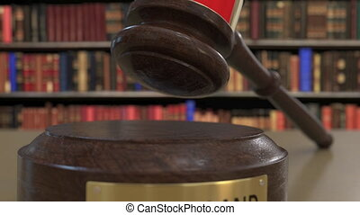Flag of Switzerland on falling judges gavel in court....