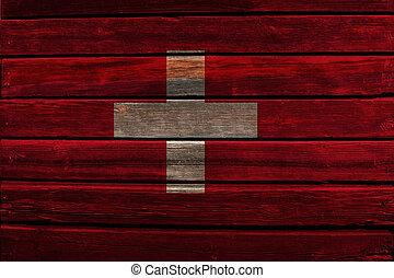 Flag of Switzerland on wood