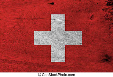 Flag of Switzerland on wooden plate background. Grunge Switzerland flag texture, It is consists of a red flag with a white cross in the centre.