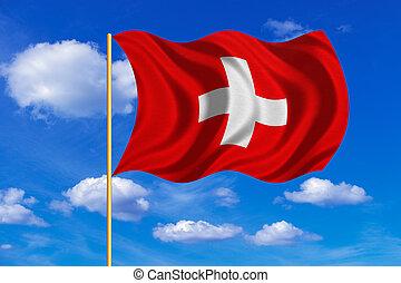 Flag of Switzerland waving on blue sky background