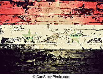 flag of Syria painted on a wall