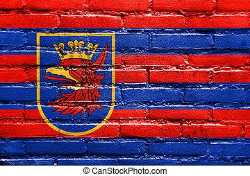 Flag of Szczecin, Poland, painted on brick wall