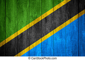 flag of Tanzania or Tanzanian banner on wooden background