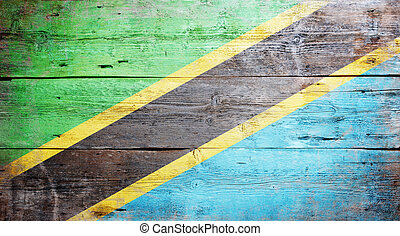 Flag of Tanzania painted on grungy wood plank background