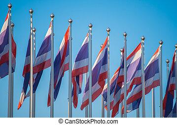 Flag of Thailand with blue sky.