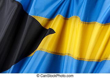 Close up shot of wavy, colorful flag of the Bahamas