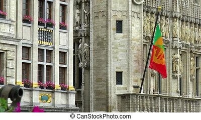 Flag of the City of Brussels at the Brussels Town Hall building, Grand Place, Belgium.
