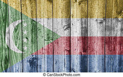 Flag of the Comoros on weathered wood