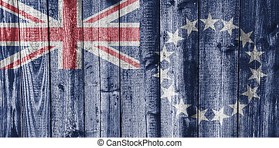 Flag of the Cook Islands on weathered wood