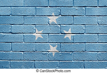 Flag of the Federated States of Micronesia on brick wall