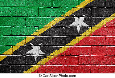 Flag of the Federation of Saint Kitts and Nevis on brick wall