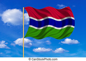 Flag of the Gambia waving on blue sky background