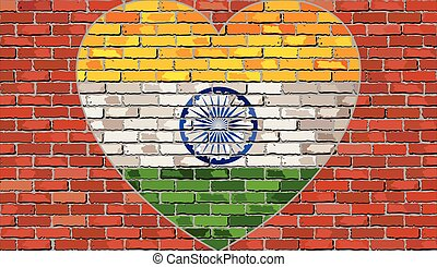 Flag of the India in a heart on a brick wall