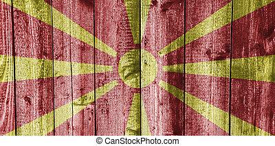 Flag of the Macedonia on weathered wood