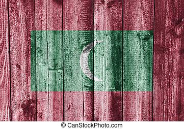 Flag of the Maldives on weathered wood
