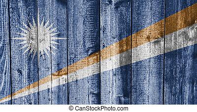 Flag of the Mashall Islands on weathered wood