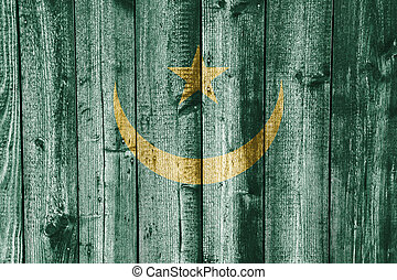 Flag of the Mauritania on weathered wood