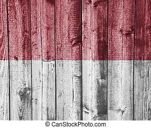 Flag of the Monaco on weathered wood