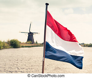 Flag of the Netherlands against windmill background