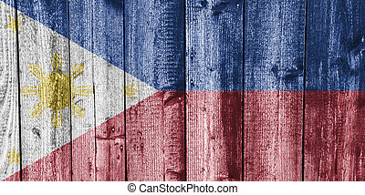 Flag of the Philippines on weathered wood