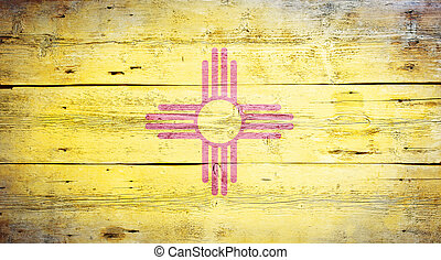 Flag of the state of New Mexico painted on grungy wooden background