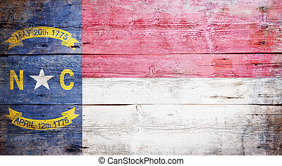 Flag of the state of North Carolina painted on grungy wooden...