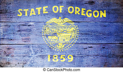 Flag of the state of Oregon painted on grungy wooden background