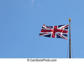 Flag of the United Kingdom on blue sky