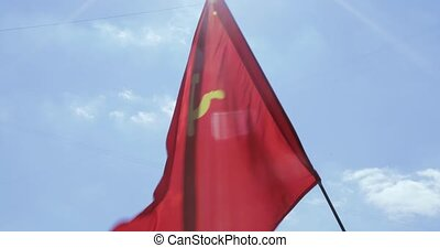 Flag of the USSR against the sky - On Communists rally...