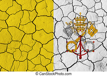 Flag of the Vatican City over cracked background