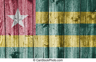 Flag of Togo on weathered wood