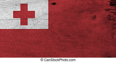 Flag of Tonga on wooden plate background. Grunge Tongan flag texture, A red field with the white rectangle on the upper hoist-side corner bearing the red Greek Cross.