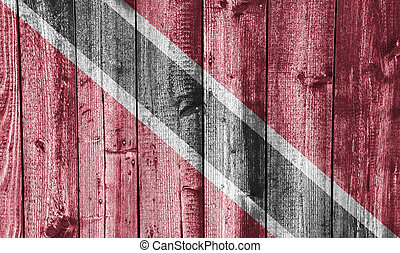 Flag of Trinidad and Tobago on weathered wood