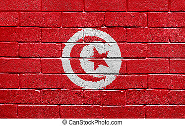 Flag of Tunisia on brick wall - Flag of Tunisia painted onto...