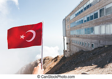 Flag of Turkey against the backdrop of Taurus Mountains