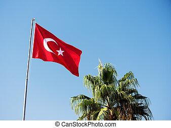 Flag of Turkey against the blue sky