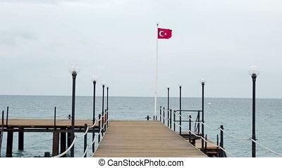 Flag of Turkey waving in the wind on outdoor lantern....